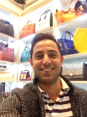 Huseyin in his handbag store.