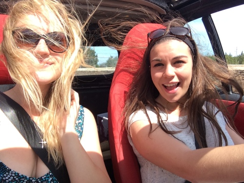 Two pretty girls and some wind-blown hair.