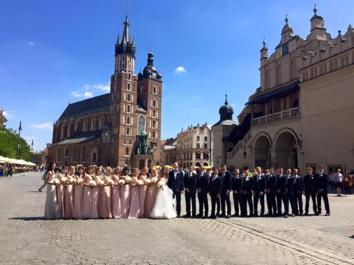 The bridal party in front of St. Mary's Church in Kraków